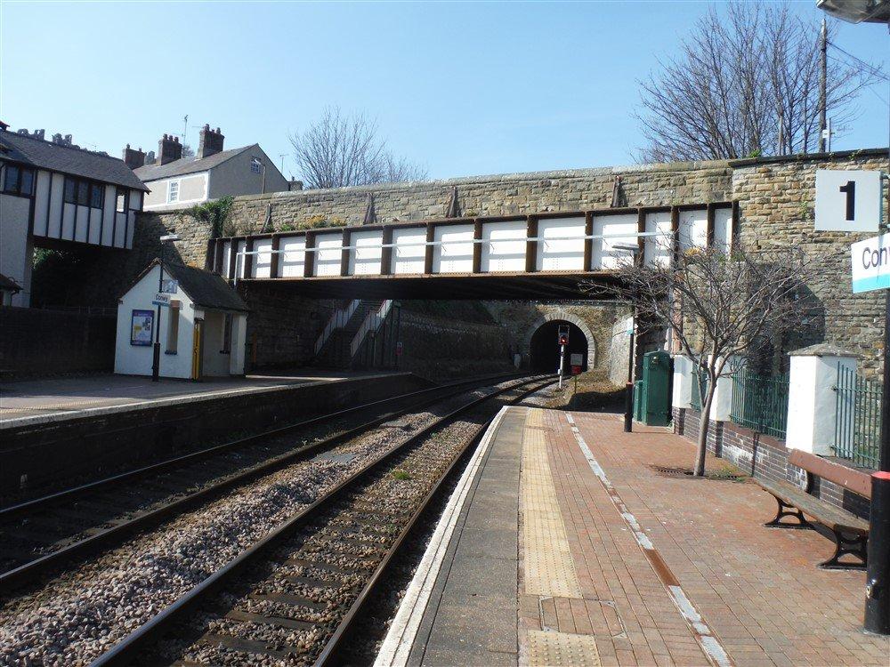 A brick overbridge at a railway station.